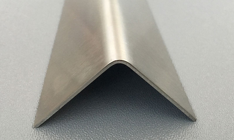 Stainless Steel Corner Guards Protect A Wall